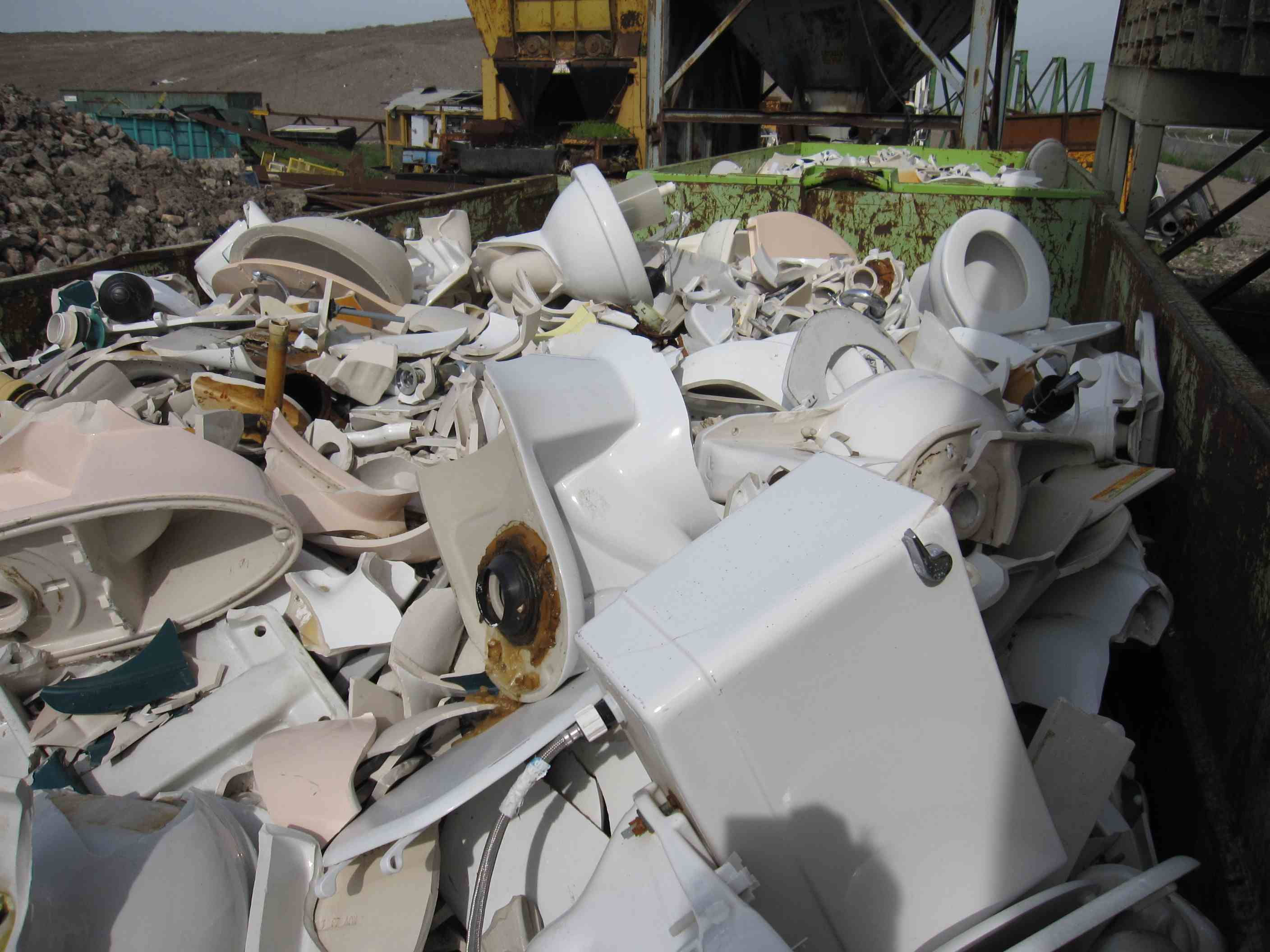 Bins of recycled porcelain at Zanker Hill Road for Tile
